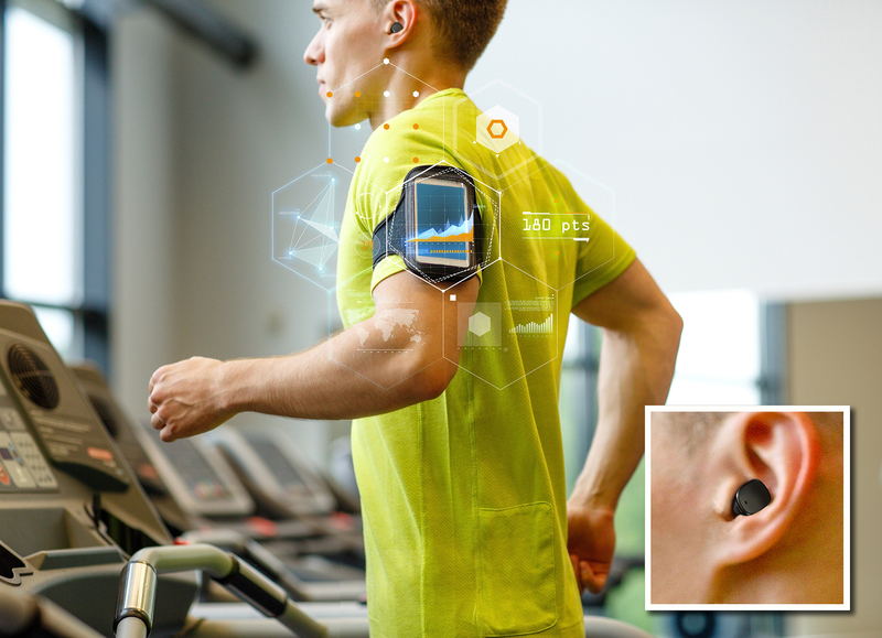 sport, fitness, lifestyle, technology and people concept - man with smartphone and earphones exercising on treadmill in gym; Shutterstock ID 214387444; PO: 19758379