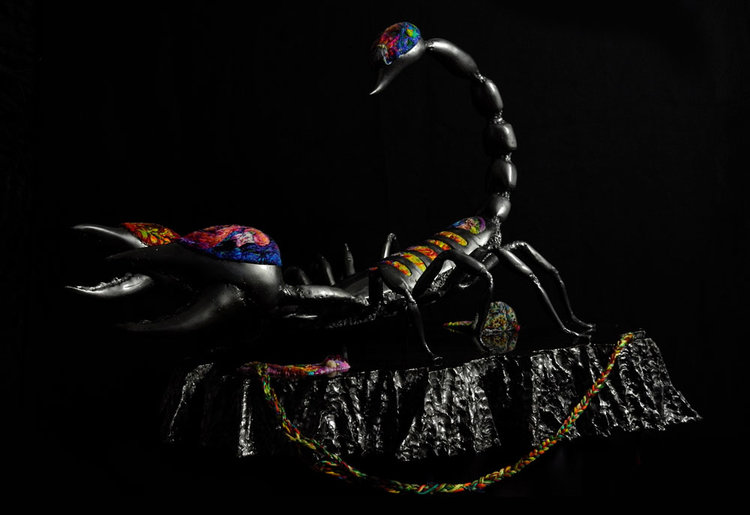 Metal scorpion made by David Madero and embroidered by Danielle Clough