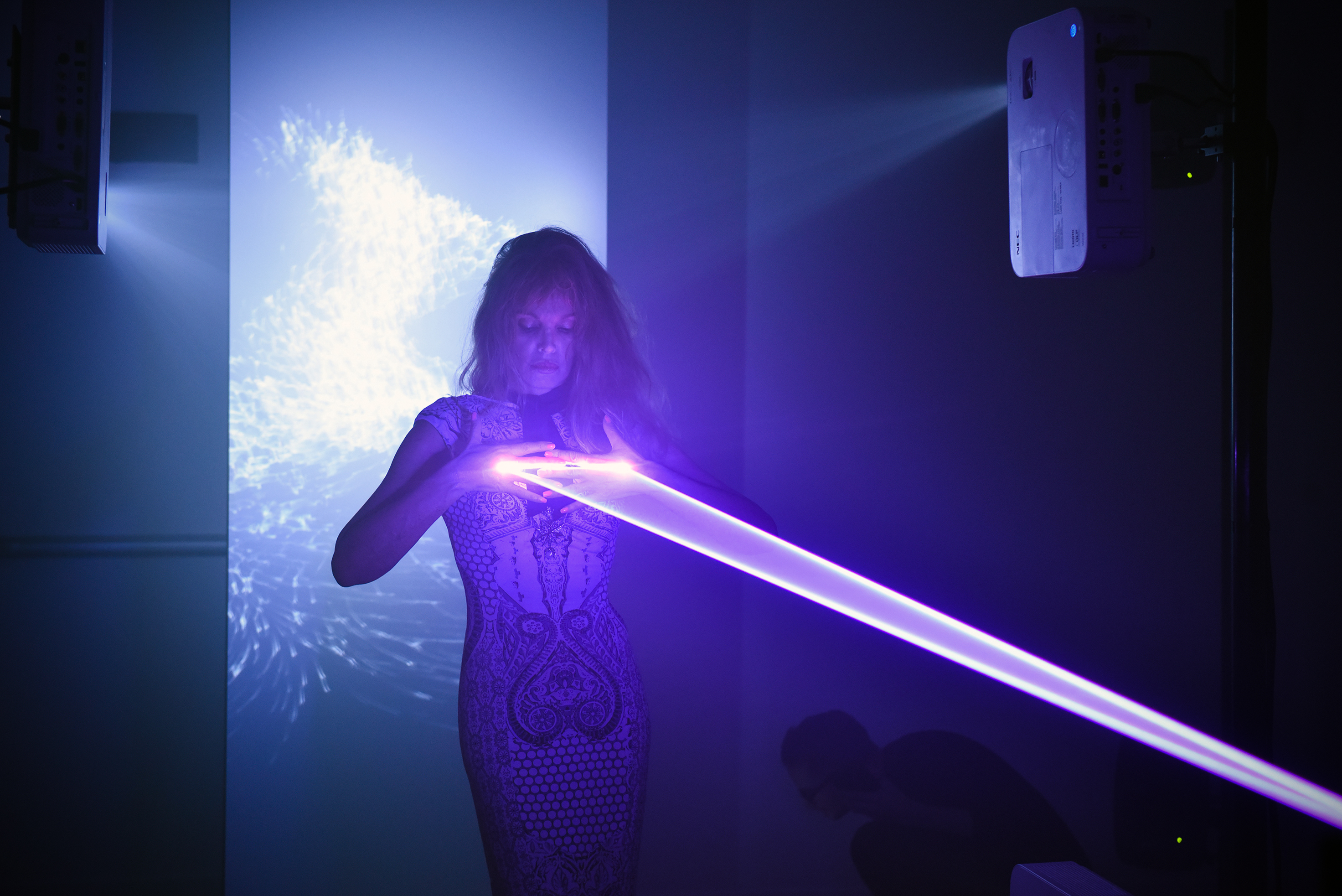 The actress Arielle Dombasie in the audiovisual installation of laser TremensS