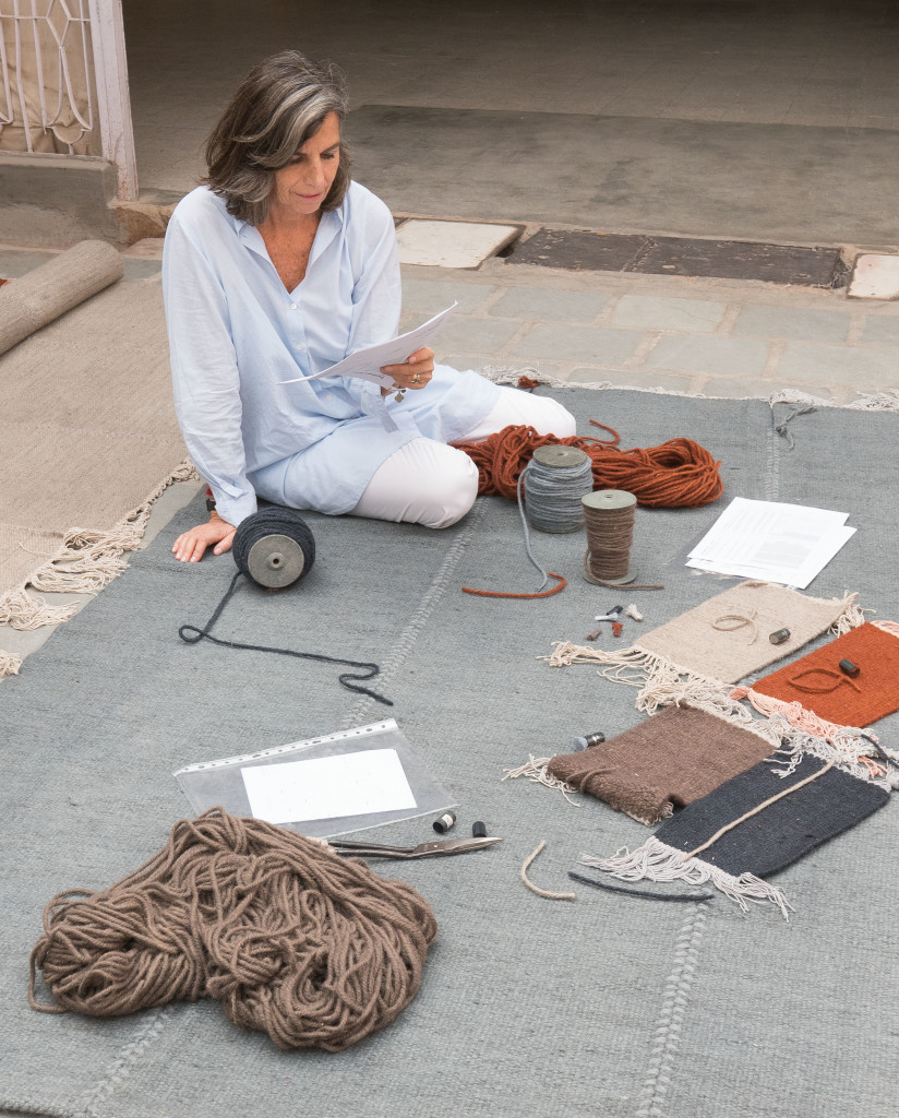 Nani Marquina in one of her rugs of the series 'Mia'.